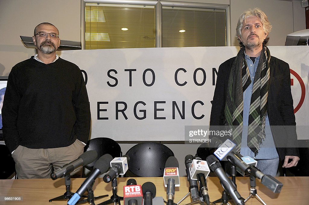Italian aid workers Marco Garatti (L) and Matteo Dell'Aira (R) from the aid agency 'Emergency' pose after answering journalists' questions during a press conference on April 23, 2010 in Milan. Marco Garatti and Matteo Dell'Aira are two of the three Italian charity workers freed on April 18 more than a week after being arrested for allegedly plotting to kill an Afghan official said investigations had proved them innocent. Matteo Dell'Aria, Marco Garatti and Matteo Pagani work for the Milan-based medical charity Emergency and were arrested on April 10 near the charity's hospital in Lashkar Gah, capital of restive Helmand province.