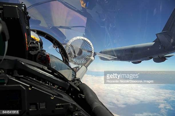 italian air force ef2000 during an in-flight refuelling with a french c-135fr tanker. - italian military stock pictures, royalty-free photos & images