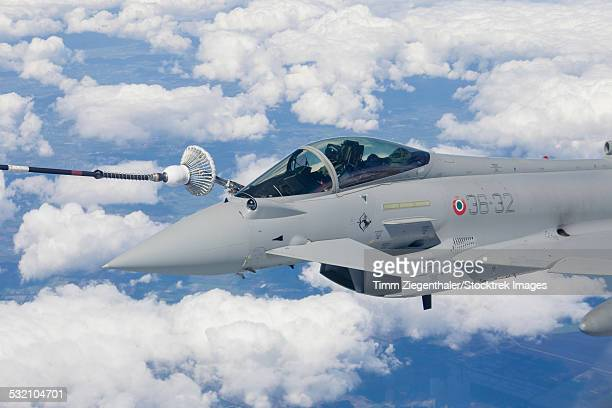 italian air force eurofighter typhoon jet of 36th stormo refueling during nato exercise jawtex 2014. - italian military stock pictures, royalty-free photos & images