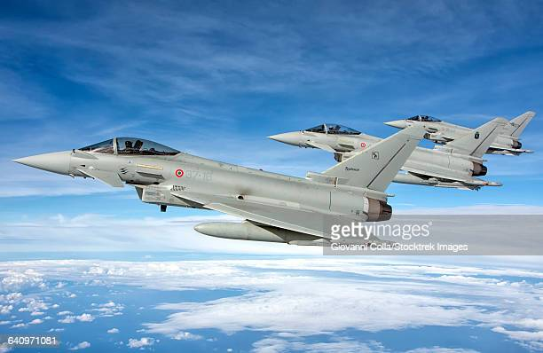 Italian Air Force F-2000 Typhoon aircraft fly in formation during Exercise Trident Juncture 2015 in Italy.