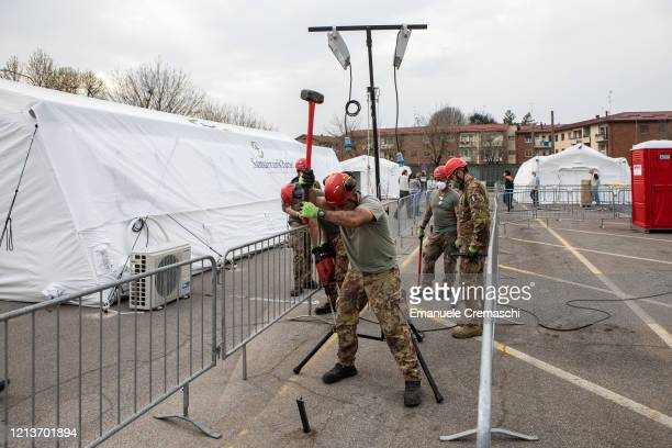 Italian Air Force officers install a light tower at a Samaritan's Purse Emergency Field Hospital on March 20 2020 in Cremona near Milan Italy...