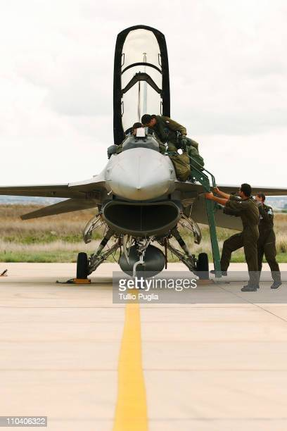 Italian Air Force pilot completes checks to a F16 plane before a flight mission at Birgi Italian Air Force Base on October 05 2006 in Trapani Italy...