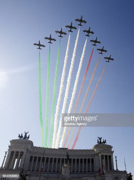 Italian Air Force's Frecce Tricolori acrobatic squad overfly the Unknown Soldier's monument during a ceremony to mark the 156th anniversary of the...