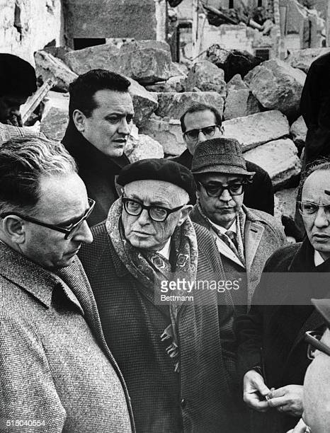 Italian Aldo Moro flanked by an unidentified man wearing glasses talks to Gibellina residents January 19th during a tour of earthquakeracked Sicily...