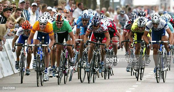 Italian Alessandro Petacchi followed by German Erik Zabel rides to victory in the final sprint in the second stage of the Holland cycling tour ran...