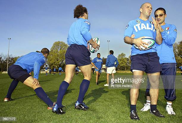 Italian Alessandro Troncon recieves treatment from physiotherapist Claudio Fossati during training for the Rugby World Cup 2003 in Canberra 17...