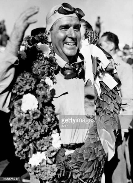 Italian Alfa Romeo driver Giuseppe Farina smiles after winning the firstever Formula One Grand Prix on May 13 1950 in Silverstone Farina won three of...