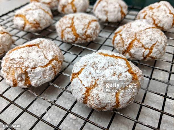 italian amaretti cookies - cooling rack stock photos and pictures