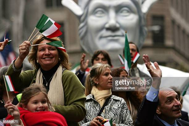 Italian Americans ride on a Columbus float while participating in the annual Columbus Day Parade October 10 2005 in New York City This is the 61st...