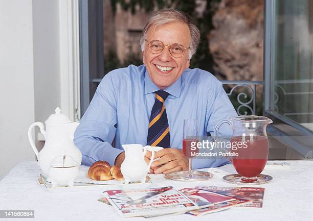 Italian anchorman and columnist Gianfranco Funari having breakfast at home 1993