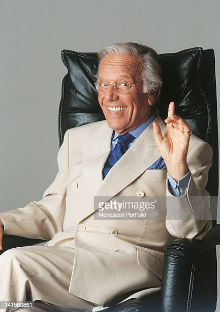 Italian anchorman and columnist Gianfranco Funari sitting in the armchair 2000