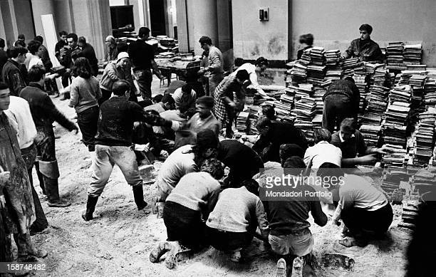 Italian and foreign students saving the books of Florence National Library after the great flood that struck the city Florence November 1966