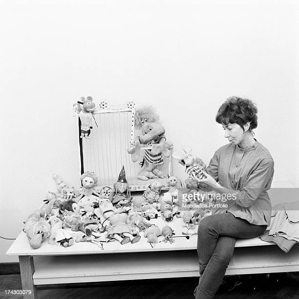 Italian animation artist Maria Perego inventor of Topo Gigio looking at a model of the famous puppet 1960s