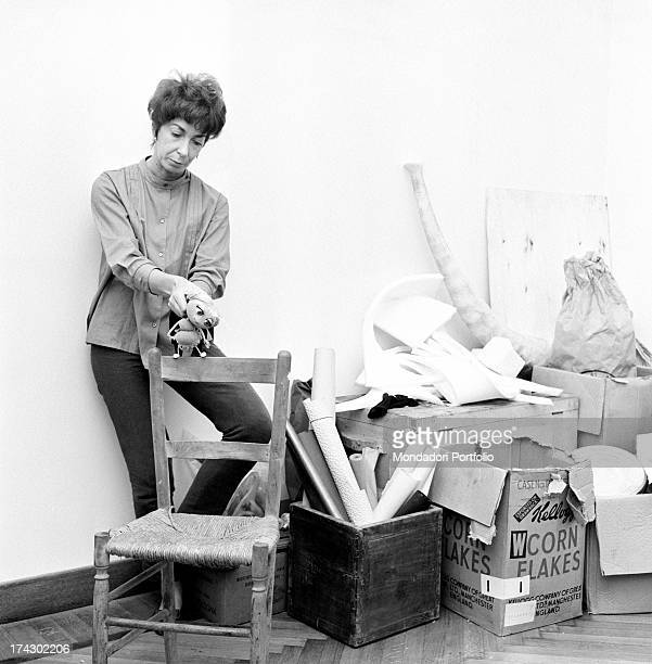Italian animation artist Maria Perego inventor of Topo Gigio moving one of her puppets on the back of a chair 1960s