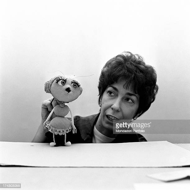 Italian animation artist Maria Perego inventor of Topo Gigio showing a puppet created by her 1960s