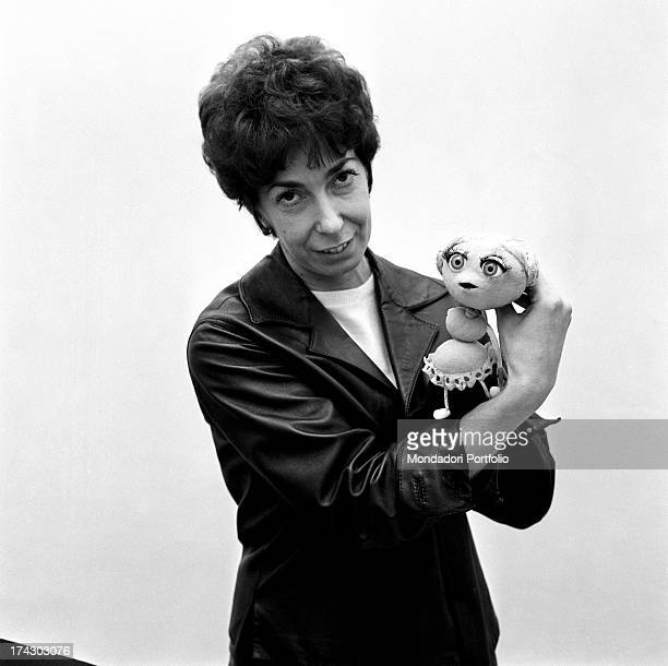 Italian animation artist Maria Perego inventor of Topo Gigio showing smiling a puppet created by her 1960s