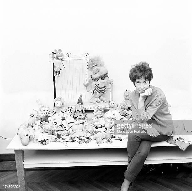 Italian animation artist Maria Perego inventor of Topo Gigio sitting on a stall full of puppets created by her 1960s