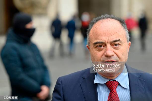 Italian anti-mafia prosecutor Nicola Gratteri is pictured with one of the members of his police protection on January 11, 2021 in Rome, two days...
