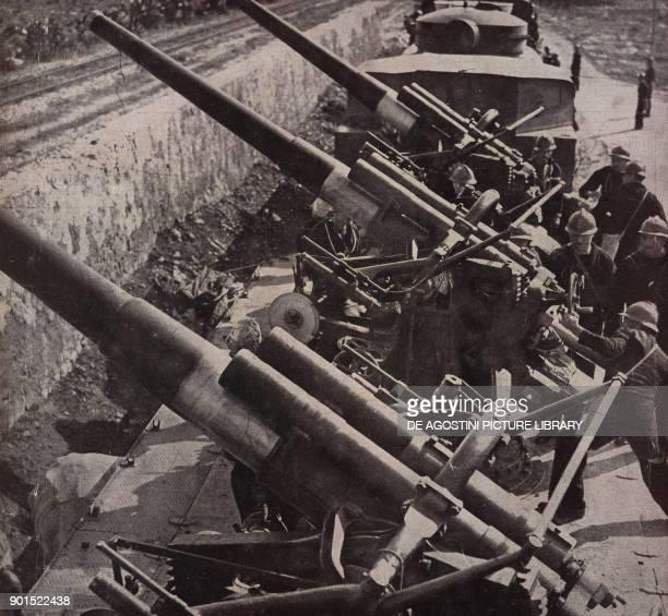 Italian armoured naval train opening fire on the enemy World War II from L'Illustrazione Italiana Year LXX No 16 April 18 1943