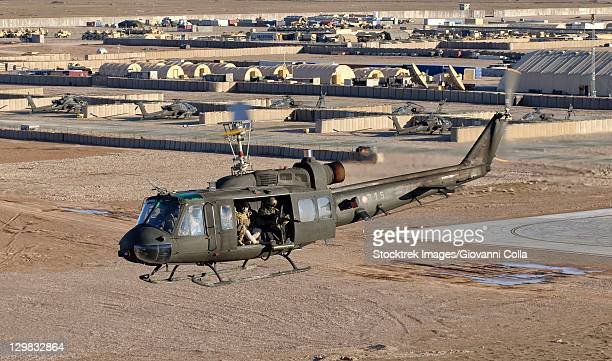 Italian Army AB-205MEP utility helicopter in flight over Shindand, Afghanistan, in support of the International Security Assistance Force (ISAF) mission.