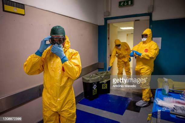Italian army doctors dress in protective suits before entering the intensive care at Celio Military Polyclinic Hospital , spoke of COVID-19...