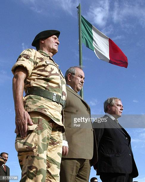 Italian Army General Filiberto Cecchi, Iraqi Prime Minister Iyad Allawi and Italian Defence Minister Antonio De Martino attend a memorial on the...