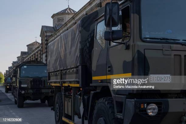 Italian army lorries transport the coffins of the victims of coronavirus in Bergamo to the crematorium on April 01, 2020 in Padua, Italy. The Italian...