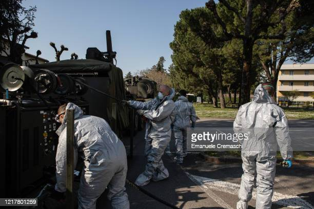 Italian Army officers belonging to the 7th CBRN Defense Regiment 'Cremona' prepare to decontaminate at Istituto Palazzolo nursing home on April 09...