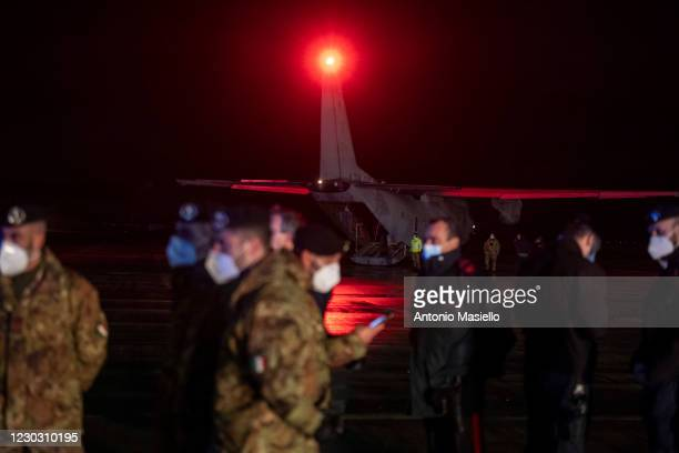 Italian Army officers wait to load doses of Pfizer-BioNTech Covid-19 vaccine on a military plane at the military airport Pratica di Mare, on December...