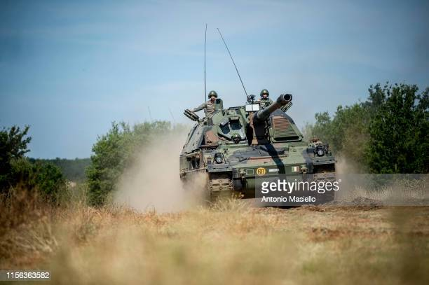 Italian Army soldiers drive a PZH 2000 military tank during the military training at an exercise camp near Rome on July 18 2019 in Monte Romano Italy...