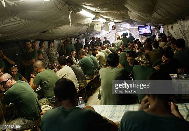 Italian Army soldiers eat in their small dining tent June 30 2010 at Forward Operating Base Todd in Bala Murghab Afghanistan The US Army's 82nd...