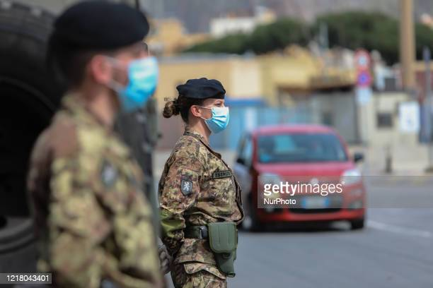 Italian Army soldiers engaged in the Safe Roads Operation and in the control of antiCovid provisions during the Lockdown in Palermo Italy on March 29...