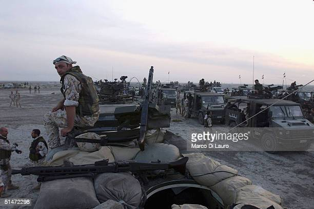 Italian Army soldiers from the Friuli Brigade of the Italian Joint Task Force Iraq wait at their base White Horse before leaving for Operation...