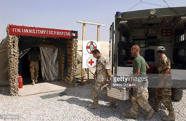Italian Army soldiers from the Italian Joint Task Force Iraq, Brigata Friuli, arrive with food for the patients at the Italian Army field hospital at...