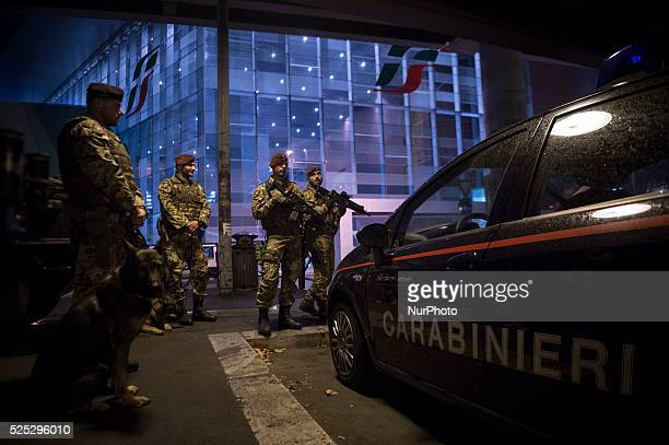 Italian Army soldiers patrol outside the Tiburtina train station in downtown Rome italy on November 23 as security is tightened after deadly attacks...