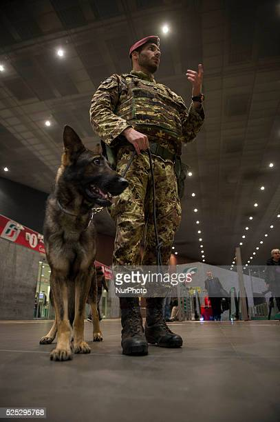 Italian Army soldiers patrol with explosive detection dogs at the Tiburtina train station in downtown Rome italy on November 23 as security is...