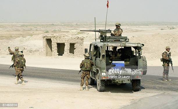 Italian Army soldiers stop a vehicle at a check point on the Tampa road from Basrah to Baghdad near the Italian base Camp Mittica on October 11 2004...