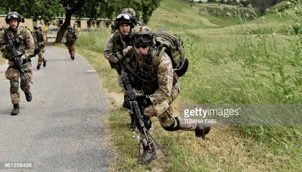 Italian Army soldiers take part in a military exercise at a training camp in Cesano near Rome on May 21 2018