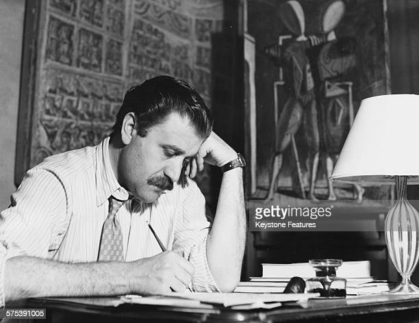 Italian art dealer Carol Cardozza working at his desk after he was announced at the recipient of the renowned art collection of Peggy Guggenheim...