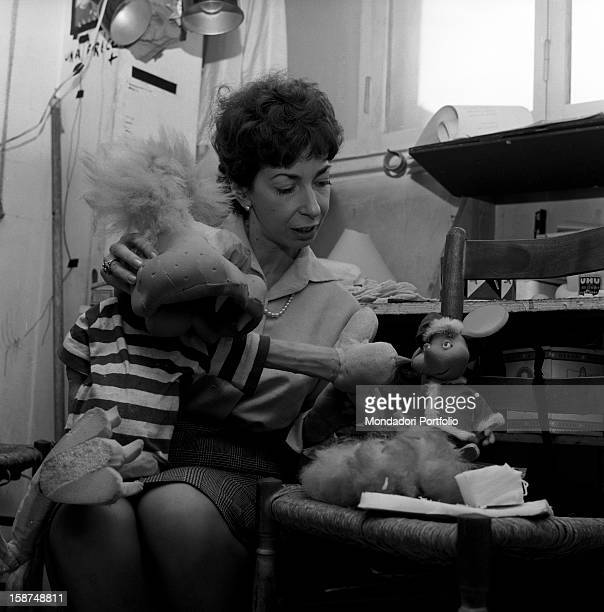 Italian artist and puppet maker Maria Perego at work and joking with Topo Gigio one of her puppets Milan 1960s