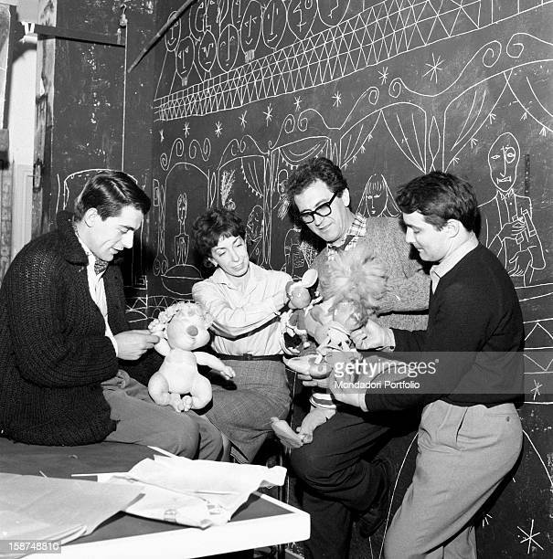 Italian artist and puppet maker Maria Perego working on her puppets with her husband Federico Caldura and some collaborators Milan 1960s