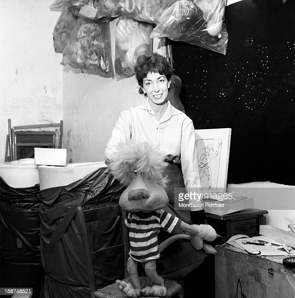 Italian artist and puppet maker Maria Perego working on one of her puppets Milan 1960s