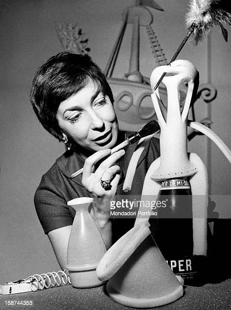 Italian artist and puppets designer Maria Perego making a puppet 1950s