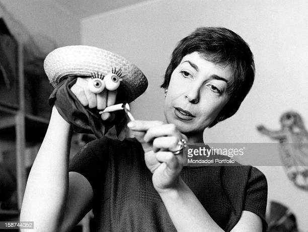 Italian artist and puppets designer Maria Perego making a puppet with her hand 1950s