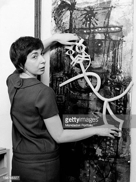 Italian artist and puppets designer Maria Perego showing one of her works 1950s