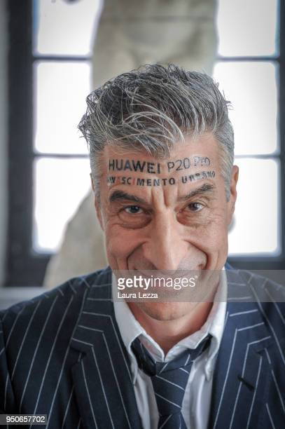 Italian artist Maurizio Cattelan poses for a photo during the ceremony where he is given title of Honorary Professor of sculpture at the Accademia...