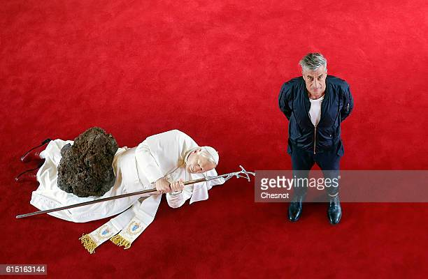 Italian artist Maurizio Cattelan poses next to his artwork La Nona Ora prior to the opening of the exhibition Not Afraid of Love at the Hotel de la...