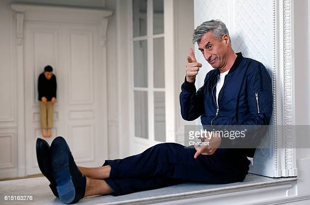 Italian artist Maurizio Cattelan poses next to his artwork La Rivoluzione Siamo Noi prior to the opening of the exhibition Not Afraid of Love at the...