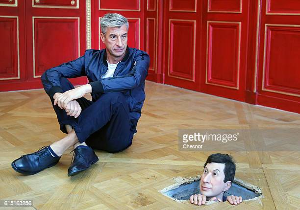 Italian artist Maurizio Cattelan poses next to his artwork Untitled prior to the opening of the exhibition Not Afraid of Love at the Hotel de la...