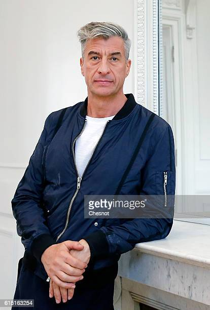 Italian artist Maurizio Cattelan poses prior to the opening of the exhibition Not Afraid of Love at the Hotel de la Monnaie on October 17 2016 in...